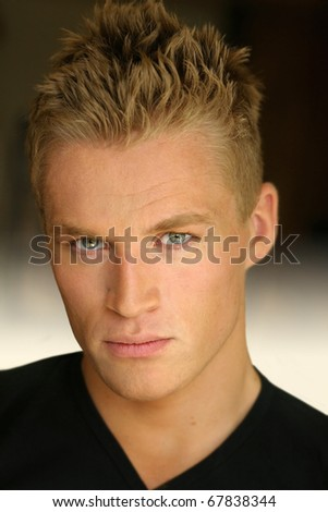 Portrait of a young good looking blond male model - stock photo