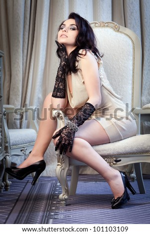 Portrait of a young gorgeous brunette in sexy gown. - stock photo