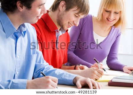Portrait of a young group of students paying attention in class - stock photo