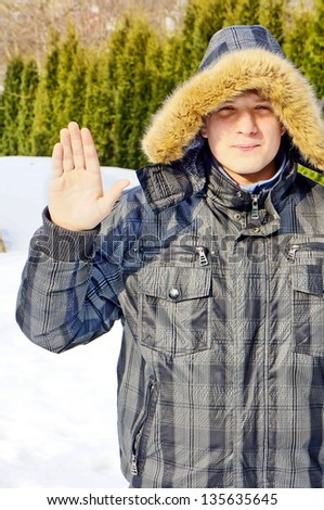 Portrait of a young guy in a winter jacket - stock photo