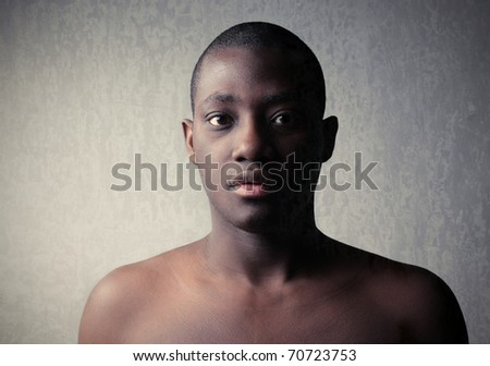 Portrait of a young handsome african man - stock photo