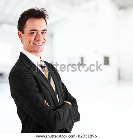 Portrait of a young handsome businessman isolated on white - stock photo