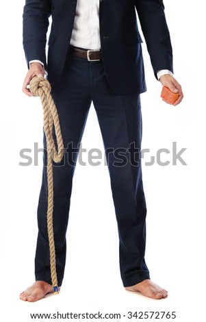 Portrait of a young handsome businessman with a rope around his neck on a white background studio