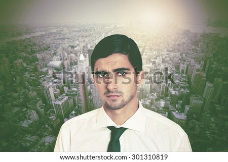 portrait of a young handsome executive with a background of New York city - stock photo