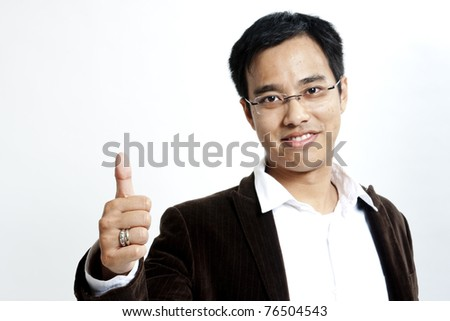 Portrait of a young handsome guy showing goodluck sign against white background - stock photo