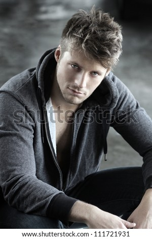 Portrait of a young handsome male model - stock photo