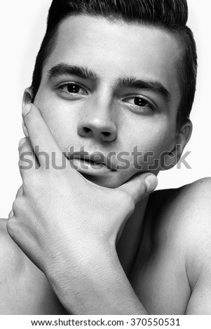 portrait of a young handsome male model young man - stock photo