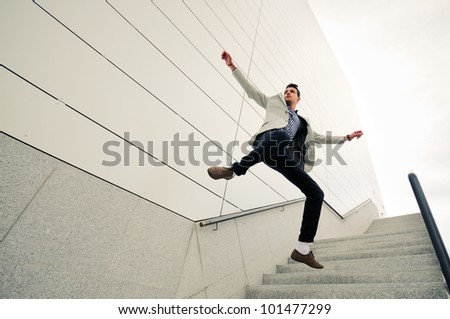 Portrait of a young handsome man, model of fashion, jumping and wearing jacket and shirt