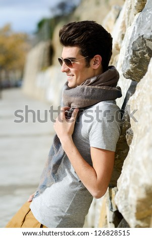 Portrait of a young handsome man, model of fashion, with sunglasses - stock photo