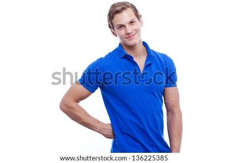 Portrait of a young handsome man wearing blue t-short isolated on white background - stock photo