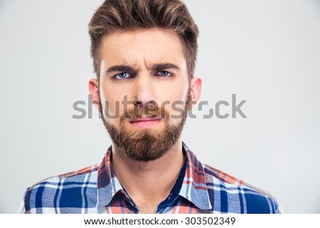 Portrait of a young handsome man with beard looking at camera isolated on a white background - stock photo