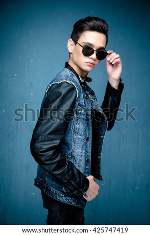 Portrait of a young handsome teenager boy. Model wearing stylish casual clothes. City lifestyle. Male fashion, street style concept.