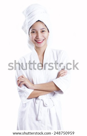 Portrait of a young happy asian lady in bathrobe.Isolated in white background. - stock photo