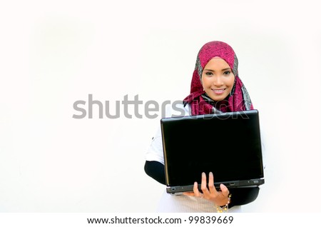 Portrait of a young happy business muslim woman with a laptop over white background