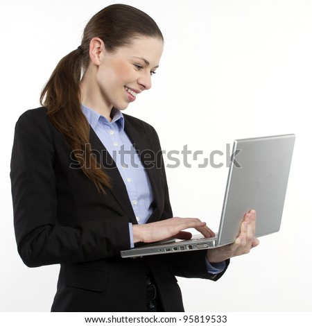 Portrait of a young happy business woman with a laptop over white background - stock photo