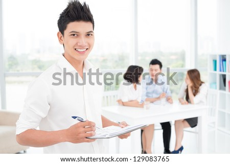 Portrait of a young happy businessman on the foreground - stock photo