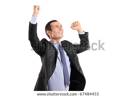 Portrait of a young happy businessman with raised hands isolated on white background - stock photo