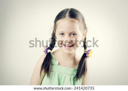 Portrait of a young happy child isolated on white - stock photo