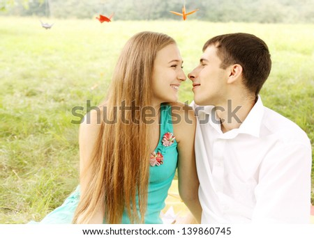Portrait of a young happy  couple on nature - stock photo