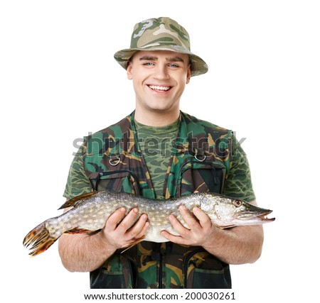 Portrait of a young happy laughing fisherman with his catch isolated on white background - stock photo