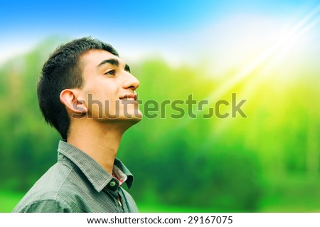 Portrait of a young happy man - stock photo