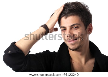 Portrait of a young happy man with cool hairstyle looking at camera. Isolated on white background. Studio horizontal image.