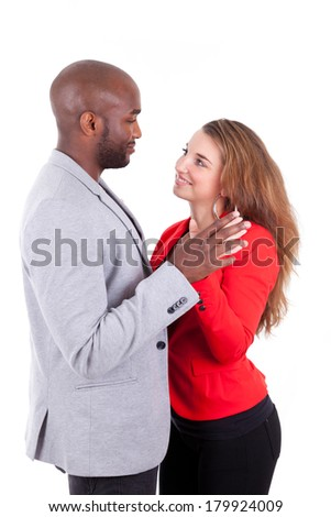 Portrait of a young happy mixed couple, isolated on white background