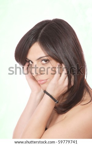 Portrait of a young happy woman over abstract background
