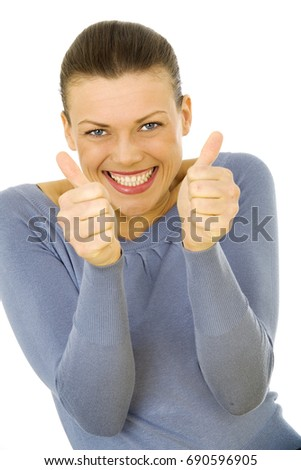 portrait of a young happy woman showing thumbs up