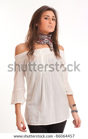 Portrait of a young haughty brunette with modern casual clothes - stock photo