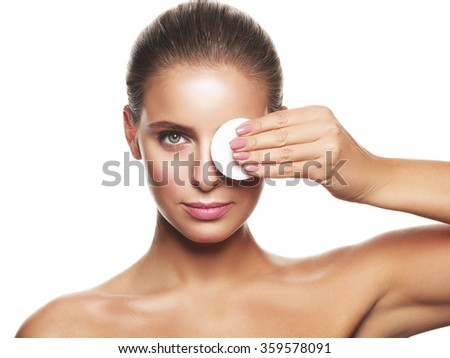 Portrait of a young healthy and beautiful girl without make up doing daily skincare using cotton pad - stock photo