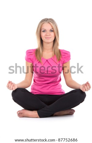 Portrait of a young healthy woman doing yoga exercises, isolated over white background - stock photo