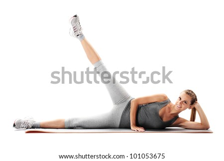 Portrait of a young healthy woman fitness exercises - stock photo