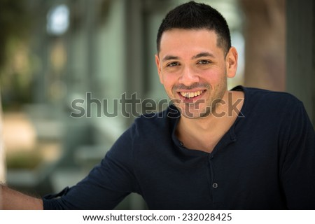 Portrait of a young Hispanic male smiling  - stock photo