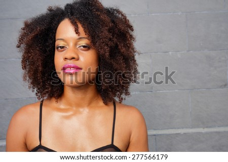 Portrait of a young Jamaican woman with an afro - stock photo