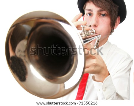 Portrait of a young jazz man playing his Trumpet white background