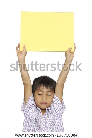 Portrait of a young kid holding a empty placard on his head against white background