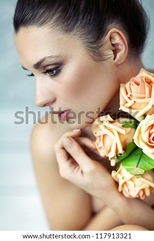 Portrait of a young lady with roses - stock photo