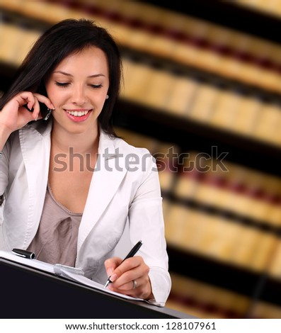 Portrait of a young lawyer working in the office - stock photo