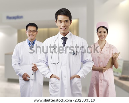 portrait of a young male asian doctor. - stock photo