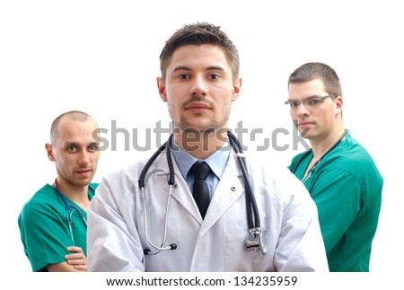 Portrait of a young male doctor with his  medical team - stock photo