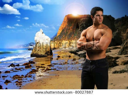 Portrait of a young male fitness model on exotic beach - stock photo