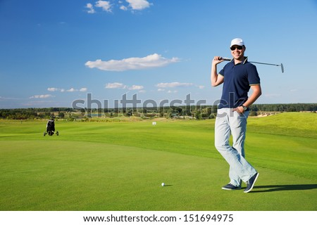 portrait of a young male golf player - stock photo