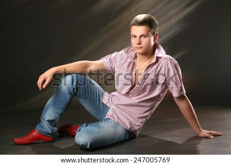 Portrait of a young male. good emotions. strength and confidence.beautiful figure - stock photo