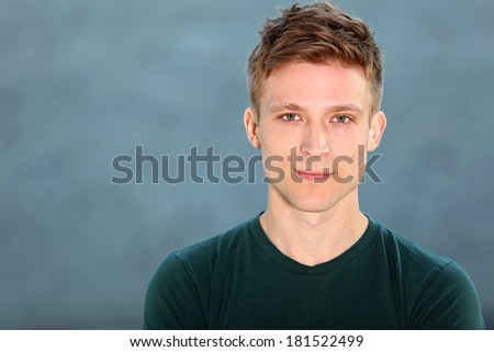 Portrait of a young man against blue - stock photo