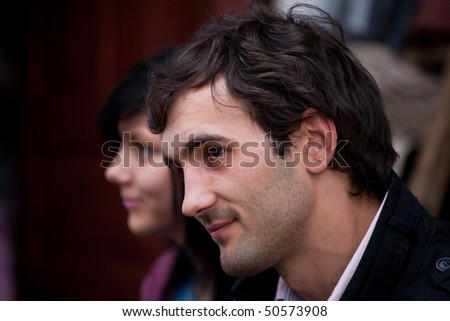 Portrait of a young man and girl outdoors - stock photo