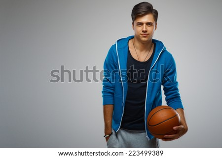 Portrait of a young man basketball player  - stock photo