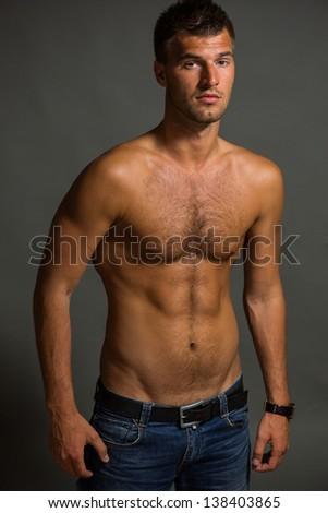 portrait of a young man bodybuilder in studio - stock photo