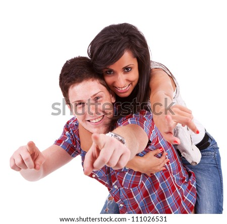Portrait of a young man carrying his girlfriend on his back with their hands pointing at the camera