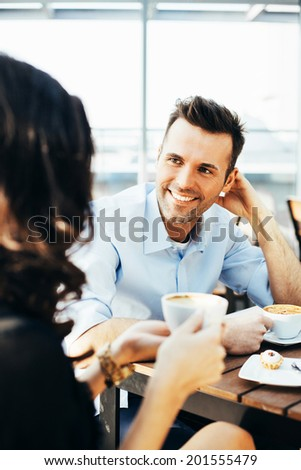 Portrait of a young man chatting with a woman - stock photo